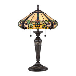 "Quoizel - Tiffany Quoizel Harland Tiffany Style Table Lamp - The delightful Tiffany style floral table lamp is constructed of nearly 300 pieces of beautiful stained art glass. Featuring a round shade with a rounded bottom edge in warm tones with cool accents. A stylized tapered metal base in Imperial Bronze finish enhances the authenticity of this iconic home accent. Two lights are controlled by dual pull chains. This elegant Quoizel lamp will warm your home with its enduring glow. Classic Tiffany style table lamp. Imperial Bronze finish. Metal construction. Leaf motif round multicolor art glass shade. Shade constructed of 283 pieces of stained glass. Two max 60 watt bulbs (not included). 24 1/2"" high. Shade is 15"" wide.   Classic Tiffany style table lamp.  Imperial Bronze finish.  Metal construction.  Leaf motif round multicolor art glass shade.  Shade constructed of 283 pieces of stained glass.  Two max 60 watt bulbs (not included).  24 1/2"" high.  Shade is 15"" wide."