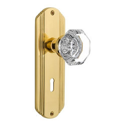 Nostalgic Warehouse - Nostalgic Deco Plate with Waldorf Knob in Polished Brass (704442) - The Deco Plate in polished brass brings to mind old Hollywood, jazz, and The Great Gatsby, all of which inspire a modern twist on great classics from the past. Pair this with our Waldorf Knob, and its crisp clean edges, for a lucent look. All Nostalgic Warehouse knobs are mounted on a solid (not plated) forged brass base for durability and beauty.