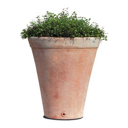 Campania International - Terra Cotta Round Usuki Planter - Set of 2 Multicolor - 8396-2402 - Shop for Planters and Pottery from Hayneedle.com! This lovely set of two Terra Cotta Usuki Adobe Planters features a tall tapered style and traditional warm terra cotta color in two different sizes. Guests will appreciate the warm inviting presence that surrounds these wonderful design elements. These premium-quality planters each feature a drainage hole to protect plant roots from over-saturation. Constructed of high-fire terra cotta and hand-glazed the Usuki set is frost-resistant for indoor and outdoor use. Dimensions: 23 diam. x 24.5H inches and 17.5 diam. x 20H inches. Set weighs 108 pounds. Benefits of Terra CottaTerra cotta Italian for baked earth is an unglazed ceramic based from clay. The history of terra cotta includes its use in the famous Terracotta Warriors statues in China. It is widely used today in building materials such as roofing and is a favorite among gardeners to house plants. Terra cotta is useful because of its low cost versatility and durability. Because it is porous terra cotta allows water to vaporize through it which is helpful to plants especially if they have an abundance of moisture. It's gas permeable so helps maintain healthy plants. Its brownish orange color comes from iron oxide in the clay. Compared to items made from other stonework terra cotta items are much lighter in weight. Overall terra cotta makes an excellent choice in the garden.About Campania InternationalEstablished in 1984 Campania International's reputation has been built on quality original products and service. Originally selling terra cotta planters Campania soon began to research and develop the design and manufacture of cast stone garden planters and ornaments. Campania is also an importer and wholesaler of garden products including polyethylene terra cotta glazed pottery cast iron and fiberglass planters as well as classic garden structures fountains and cast resin statuary.Campania Cast Stone: The ProcessThe creation of Campania's cast stone pieces begins and ends by hand. From the creation of an original design making of a mold pouring the cast stone application of the patina to the final packing of an order the process is both technical and artistic. As many as 30 pairs of hands are involved in the creation of each Campania piece in a labor intensive 15 step process.The process begins either with the creation of an original copyrighted design by Campania's artisans or an antique original. Antique originals will often require some restoration work which is also done in-house by expert craftsmen. Campania's mold making department will then begin a multi-step process to create a production mold which will properly replicate the detail and texture of the original piece. Depending on its size and complexity a mold can take as long as three months to complete. Campania creates in excess of 700 molds per year.After a mold is completed it is moved to the production area where a team individually hand pours the liquid cast stone mixture into the mold and employs special techniques to remove air bubbles. Campania carefully monitors the PSI of every piece. PSI (pounds per square inch) measures the strength of every piece to ensure durability. The PSI of Campania pieces is currently engineered at approximately 7500 for optimum strength. Each piece is air-dried and then de-molded by hand. After an internal quality check pieces are sent to a finishing department where seams are ground and any air holes caused by the pouring process are filled and smoothed. Pieces are then placed on a pallet for stocking in the warehouse.All Campania pieces are produced and stocked in natural cast stone. When a customer's order is placed pieces are pulled and unless a piece is requested in natural cast stone it is finished in a unique patinas. All patinas are applied by hand in a multi-step process; some patinas require three separate color applications. A finisher's skill in applying the patina and wiping away any excess to highlight detail requires not only technical skill but also true artistic sensibility. Every Campania piece becomes a unique and original work of garden art as a result.After the patina is dry the piece is then quality inspected. All pieces of a customer's order are batched and checked for completeness. A two-person packing team will then pack the order by hand into gaylord boxes on pallets. The packing material used is excelsior a natural wood product that has no chemical additives and may be recycled as display material repacking customer orders mulch or even bedding for animals. This exhaustive process ensures that Campania will remain a popular and beloved choice when it comes to garden decor.Please note this product does not ship to Pennsylvania.