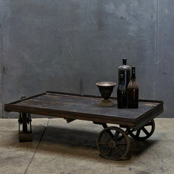 Vintage Industrial Cart Coffee Table - What? Okay, sure, you could go with that standard monstrosity of a coffee table but this gorgeous specimen will get the conversation going (while the cocktails have a chance to get caught up!). Plus, those wheels will come in mighty handy when y'all need a little more room on the dance floor.