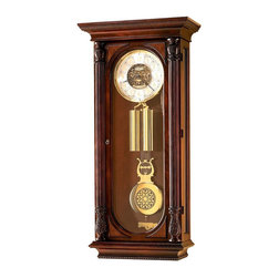 """Howard Miller - Howard Miller - Stevenson Wall Clock - This exquisite Rare Limited Edition Pendulum Wall Clock in White Ash Burl is one of only two thousand inscribed models. Features of this marvelous 3�_�۪ tall wall clock include a beveled glass door, a polished brass lyre pendulum and intricate carved detailing. * A most elaborate Limited Edition wall clock. Only two thousand will be crafted and inscribed. Stands over 3-1/2 feet tall. Features a profiled pediment with decorative molding on the front and sides. Rare white ash burl overlays frame the beveled glass on the door along with two reeded columns with elaborately carved column caps.. Beveled glass continues on the sides. . The inscribed dial offers a pierced cast center and applied numerals. . A polished brass lyre pendulum with a cast center swings above the detailed beat plate. Polished brass weight shells also complement the case. . Decorative rope-styled molding appears on the front and sides of the base. . Finished in Windsor Cherry on select hardwoods and veneers. . Key-wound, triple chime movement with automatic nighttime chime shut-off option and durable bronze bushings. . H. 44-1/4"""" (113 cm) x W. 21-1/4"""" (54 cm) x D. 10"""" (25 cm)"""