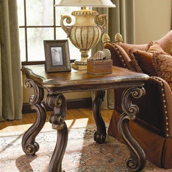 Hooker Furniture - Beladora Lamp Table - Made from hardwood solids with maple, olive ash burl and walnut veneers with resin accents. Caramel finish with gold tipping. 31.75 in. W x 31.75 in. D x 27.75 in. H. Assembly InstructionsThe 70-piece Beladora collection of bedroom, dining, living room tables, home office and home entertainment furniture is the epitome of the grand European elegance many are looking for. Enrich you surroundings with the grand European elegance of Beladora. If you appreciate traditional forms, exquisite shapes, graceful curves and artistic hand work, the Beladora office collection by Hooker Furniture will inspire you as you work in your personal office space. The collection is dramatic and graciously scaled with maple and olive ash burl veneers accented by distinctive walnut inlays. Beladora pays homage to costly Old World antiques and showcases its exceptional design with a refined caramel finish with subtle gold tipping to accent the carving, chiseling and marquetry work all done by the hands of skilled craftsmen.