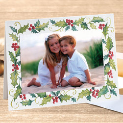 """Exposures - Cheerful Holly Photo Christmas Card Set of 18 - Overview The merry spirit of the holiday season is captured in this hand painted holly design, a delightful border for your special photo. Our exclusive photo cards are the perfect way to stay in touch and share a smile with family and friends during the holiday season Features:  Pre-printed interior verse: """"Merry Christmas  Happy New Year."""" Premium white card stock with a textured finish Set of 18 photo mount cards Designed to accommodate either horizontal or vertical photos Includes adhesive dots to attach your photo Includes 20 coordinating gold foil-lined white envelopes Includes free gold foil envelope seals to add a special finishing touch   Personalization  Card personalization available in a coordinating color and font, imprinted below the pre-printed verse; up to 3 lines, 50 characters per line  Select horizontal or vertical placement to match orientation of your photo  Envelope personalization available in a coordinating color and font, imprinted on the back flap of the envelope; up to 3 lines, 48 characters per line   Specifications  Folded card size 8"""" wide x 6"""" high Holds one horizontal or vertical 4"""" x 6"""" photo   Shipping  Please allow an additional 2 weeks for imprinted items No returns on personalized items unless the item is damaged or defective"""