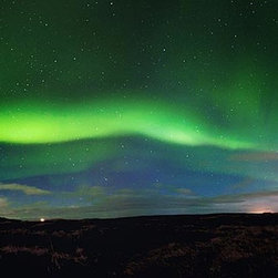 Magic Murals - Northern Lights Panorama Wall Mural -- Self-Adhesive Wallpaper by MagicMurals - This astronomical phenomena, also known as the aurora borealis, was captured on a winter's evening in Iceland.  The green lights glow in the sky and, many folks say, you can hear the atmosphere hum.