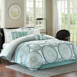Madison Park - Madison Park Delphine 7 Piece Comforter Set - Give your bedroom a fresh, updated look with the Madison Park Delphine collection. The comforter features a blue and grey floral medallion print that is pieced with embroidered blue medallion pattern next to a solid grey pleated section. The set includes a solid blue bedskirt. Three embellished decorative pillows are included in the set to complete the overall look. Comforter & sham face: 100% polyester micro fiber 75gsm print pieced with embroidery, reverse: polyester microfiber 75gsm solid. Comforter with 250gsm poly fill. Pillows: 100% polyester cover with poly fill; Bedskirt: non woven platform and micro fiber 75gsm drop