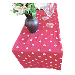 """Divine NY & Co. - Red Dot Cotton Table Runner - Add a splash of color to your table with this eye-catching red table runner. Embellished with a traditional Indian style """"bandini"""" dot print."""