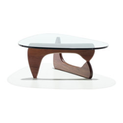 Herman Miller - Herman Miller Noguchi Table - The perfect balance—literally—between art and furniture. Sculptor Isamu Noguchi created his distinctive table by joining a curved, wood base with a freeform glass top. The ethereal result does not diminish the practical design—a sturdy and durable table. This marriage of sculptural form and everyday function has made the Noguchi table an understated and beautiful element in homes and offices since its introduction in 1948.