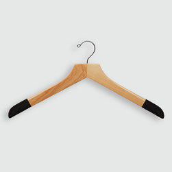 "Frontgate - Set of Five Luxury Men's Sweater/Polo Hangers - Available in 100% birch wood with high-gloss Bubinga Finish, purple flocking, and brass hardware or 100% maple wood construction with satin finish, black flocking, and chrome hardware. Available in three different widths for optimal sizing. Features 1"" shoulder flare and curved tip, eliminating shoulder dimpling while offering up to three times more surface area and support than average hangers. With our Luxury Men's Sweater/Polo Hangers, you can protect and extend the life of your sweaters and polo or golf shirts while avoiding embarrassing shoulder dimpling, which is caused when hangers do not extend all the way to the edge of the shoulder. Shoulder flocking helps ""grip"" the garment, thereby further preventing stretching that occurs as garments slide down the clothes hanger.  .  .  ."