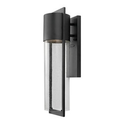 "Hinkley - Asian Hinkley Shelter 20 1/2"" High Indoor/Outdoor Wall Light - A charming modern look that can be placed anywhere flattering additional light is needed. Clear seedy glass brings traditional allure while the clean lines make it decidedly modern. Black finish. Clear seedy glass. Dark sky rated. Takes one 60 watt bulb (not included). Backplate is 12"" high and 4 1/2"" wide. 5 3/4"" from mounting point to top of fixture. 6 1/4"" wide. 20 1/2"" high. Extends 6 1/2"" from the wall.  Hinkley Shelter collection indoor/outdoor wall light.  Black finish.   Clear seedy glass.   Dark sky rated.   Takes one 60 watt bulb (not included).   Backplate is 12"" high and 4 1/2"" wide.   5 3/4"" from mounting point to top of fixture.   6 1/4"" wide.   20 1/2"" high.  Extends 6 1/2"" from the wall."