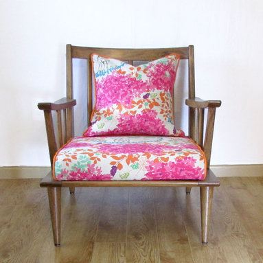 Before & After - Spindle-lounge chair, refinished in deep pecan and upholstered in a fabulous eclectic pattern with deer, elk, spiderwebs, butterflies, flora and vines.