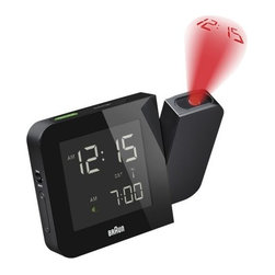 Braun - Digital Tilt Projection Alarm Clock by Braun - With the Braun Digital Tilt Projection Alarm Clock, you can tell the time without even looking at the clock. Simply wave your hand in front of the motion detector, and the adjustable side arm projects the time onto the wall or ceiling. The clock itself has a large backlit digital LCD display and an easy quick-set function for the time and alarm time. Best known as a maker of electric shavers and other grooming products, Braun also uses its proclivity for precision in the production of timepieces. The line of Braun clocks and watches--called Braun Time--is thoughtfully yet simply designed for ease of use and versatility in any number of settings. Whether on the desk or next to the bed, Braun alarm clocks are pieces you'll actually be glad to wake up to.
