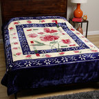 None - Royal Mink Blue Blanket - You'll unleash a sea of colors in the midst of your bedroom when you cover your bed with this blue polyester blanket. The blanket includes vibrant floral patterns in blue, red, and white, which work together to brighten up your room's decor