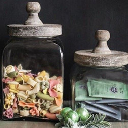 Square Glass Canisters - Square glass canisters are a pretty way to contain lots of things! Tea bags, wrapped candy, seashells, spools of thread, even coins will all look great filling in the corners. A vintage looking wood top seals the deal.