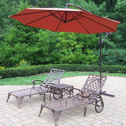 Oakland Living - 4-Pc Outdoor Traditional Chaise Lounge Set - Includes two chaise lounges, side table and 120 in. Dia. cantilever umbrella. Crisp and stylish traditional lattice pattern and scroll work. Lightweight. Metal hardware. Fade, chip and crack resistant. Warranty: One year limited. Made from rust-free cast aluminum. Antique bronze hardened powder coat finish. Minimal assembly required. Chaise Lounge: 71 in. L x 25.5 in. W x 35 in. H (68 lbs.). Side table: 17.5 in. W x 17.5 in. D x 19 in. H (15 lbs.)The Oakland Mississippi Collection combines southern style and modern designs giving you rich addition to any outdoor setting. This set will be beautiful addition to your patio, balcony or outdoor entertainment area. Our Chaise lounger sets are perfect for any small space or to accent larger space. We recommend that products be covered to protect them when not in use. To preserve the beauty and finish of the metal products, we recommend applying epoxy clear coat once a year. However, because of the nature of iron it will eventually rust when exposed to the elements.