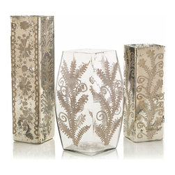 Etched Mercury Glass Vases - Set of 3 - Complex traditional floral patterns are softly described in the walls of the Etched Mercury Glass Vases, a set of three elegant and sprightly upscale glassware pieces for arrangement in the high-end home.  Beautiful with a few coordinated sprigs trimmed from the garden, these vases can also be scattered over an �tag�re or through a bedroom for a stunning frosty shimmer.