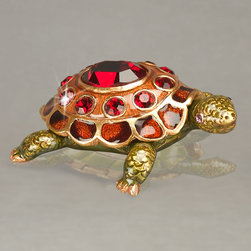 Jay Strongwater - Turtle Birthstone Box - EMERALD (MAY) - Jay StrongwaterTurtle Birthstone BoxDetails Each handcrafted turtle-shaped box features intricate detailing on top and bottom. Shell lifts up to reveal a spot to hide treasures.January red garnet-hue enamel and crystals.February purple amethyst-hue enamel and crystals.March aquamarine-hue enamel and crystals.April white enamel with diamond-like clear crystals.May green emerald-hue enamel and crystals.June white enamel with pearlescent cabochons. July red ruby-hue enamel and crystals.August lime green peridot-hue enamel and crystals.September blue sapphire-hue enamel and crystals.October opalescent enamel and cabochons.November orange citrine-hue enamel and crystals.December blue topaz-hue enamel and crystals.About Jay Strongwater:Though his jewelry collection began as modest gifts for his mother his line soon sparkled on runways and in fashion magazines. Following this success he turned his attention to home and then to beauty using his trademark old-world handcrafted techniques and Austrian crystals.Designer About Jay Strongwater:Jay Strongwater's love of the elegant but vividly bejeweled objet whether it's meant to rest on a tabletop or the graceful curve of a woman's neck has led him on a journey through the worlds of fashion and home furnishings. He began his career while a student at the Rhode Island School of Design. After garnering raves for a necklace he'd made his mother he took jewelry samples to open buyer days at some of New York's finest department stores and soon a burgeoning business was born. At the age of 23 Strongwater met designer Oscar de la Renta with whom he began to collaborate on jewelry designs for runway shows. The move to home accessories was delightfully serendipitous & organic. For the 1994 holiday season Strongwater sent gifts of jewel-encrusted filigree picture frames to friends fashion editors and buyers who immediately fell in love with the design. By 1998 his Jewels for the H