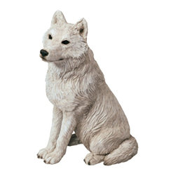 Sandicast - Sandicast Mid Size Gray Artic Wolf Sculpture - MS505 - Shop for Sculptures Statues and Figurines from Hayneedle.com! Take a walk on the wild side with the Sandicast Mid Size Gray Artic Wolf Sculpture. Known for its resilience and beauty this wolf graces any space with exceptional handcrafted detail.About Artist Sandra Brue and SandicastBased in San Diego artist Sandra Brue has been creating art for 25 years. Her hand-cast hand-painted pieces are beloved for their stunning lifelike qualities. Sandra founded Sandicast in 1981 in San Diego; in 2005 the Neufeld family acquired Sandicast in order to allow Sandra more time to devote to philanthropic endeavors. The company is still a proud vendor of Sandra Brue's sculptures.How to care for your Sandicast Statues:Regularly dust Sandicast statues with a dry soft toothbrush in order to keep them looking their best. To wash them moisten a terry towel and gently wipe them down. You may use soap on white areas but make sure not to use soap on any painted areas as this could damage your sculpture. To avoid maximum wear and tear don't expose your statues to harsh elements. A few precautions and you'll enjoy your sculpture for years to come.
