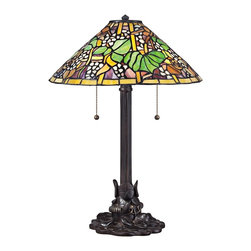 "Quoizel - Tiffany Quoizel Tropical Tiffany Style Table Lamp - Bring the classic majesty of Tiffany lighting into your home with art glass table lamp inspired by Tiffany designs. The round tropical floral shade is composed of individual pieces of stained glass expertly arranged and constructed. A stylized Imperial Bronze finish metal base enhances the authenticity of this iconic home accent. This elegant Quoizel lamp will warm your home with its enduring glow. Floral and leaf art glass table lamp. Imperial Bronze finish. Metal construction. Multicolor art glass shade. Shade constructed of 561 pieces of stained glass. Two max 60 watt bulbs (not included). 20"" high. Shade is 14"" wide.   Floral and leaf art glass table lamp.  Imperial Bronze finish.  Metal construction.  Multicolor art glass shade.  Shade constructed of 561 pieces of stained glass.  Two max 60 watt bulbs (not included).  20"" high.  Shade is 14"" wide."