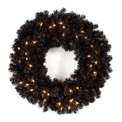 East West Basics (HK) Ltd - 24 in. Classic Black Pre-lit Wreath - TI920-B300BE-50LC - Shop for Holiday Ornaments and Decor from Hayneedle.com! The 24 in. Classic Black Pre-lit Wreath isn t your average holiday wreath. The bold black coloring allows this wreath to stand alone as a holiday decoration though the 300 tips allow for a wide variety of additional decorations. This wreath has 50 pre-strung lights so you won t have to worry about hassling with tangled wires assuring a simple and tasteful look wherever it's hung.