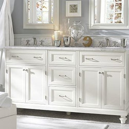"Modular Classic Double Sink Console with Doors & Drawers, White with White Marbl - Our elegant wide sink console is topped with a thick slab of Carrara marble that is roomy enough to keep all bath essentials close at hand. It's designed with smooth, turned feet and finely beveled edges, and features drawers and cabinets for convenient storage. 65.5"" wide x 22"" deep x 36"" high Sink consoles are constructed of poplar wood and MDF. Base and floor pieces are constructed of poplar and birch wood. Top is made of 1""-thick honed Italian Carrara marble, known around the world for its exceptional quality and natural beauty. Polished nickel hardware installed with chrome and satin nickel options included. Use with any of our faucet collections (sold separately). Professional installation required. View our {{link path='pages/popups/fb-bath.html' class='popup' width='480' height='300'}}Furniture Brochure{{/link}}."
