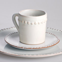 Charlot Cup and Saucer - A dimensional, slightly overscaled beaded band details the handcrafted look of the Charlot Cup, with a smaller repeat of the simple and traditional motif on the edges of the matching Saucer.  Perfect for offering coffee and tea whether with breakfast or with dessert, this simple and timeless set is glazed in a sweet-cream color to provide the dishes' elegant gloss and artisan looks.