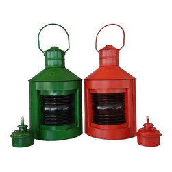 Handcrafted Nautical Decor - Red and Green Port and Starboard Lanterns 14'' - The Red and Green Port and Starboard Lanterns 14'' are an authentic   and   functional set of ship lamps. Handcrafted from cast iron to create a     realistic port and starboard replica lantern as used onboard tall    ships, this ship lantern   is true to the original design of period    lamps. Each lamp can be idenified by the words ''Port'and ''Starboard'at   the top of each lantern. Our  boat lantern is  fully  functional and simply  needs oil to omit  light.--Dimensions: 7'Long x 5'Wide x 14'High----    These tin nautical oil lamps are handcrafted by our master artisans--    Port and Starboard lanterns sold in a set of two--    Authentic lamp replica - modeled after a 19th century nautical lamp--    Handle rests atop boat lantern - easy to carry and mount--    Sturdy cage helps protect the glass--    Fully functional nautical light (comes with wick installed), just add oil (sold separately)--