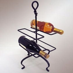 """J & J Wire 4-Bottle Wine Holder - Put your budding sommelier skills to good use by keeping a variety of fine wines on hand in the J & J Wire 4-Bottle Wine Holder. The signature hand-forged knot design on top makes a perfect handle so you can have your """"""""kit"""""""" of four delicious vintages available at all times. Proudly made in the USA from wrought iron with a black powder-coat finish this freestanding unit has an elegant architectural look that works well in any setting.About J & J Wire Inc.Located at the Industrial Park in Beatrice Nebraska J & J Wire Inc. started 25 years ago as a wire-forming business manufacturing mostly houseware items. Since then the company has grown into a metal fabrication business serving customers in many different manufacturing sectors in the United States and Canada. From quilt racks to wine racks J & J Wire is committed to creating handmade works of art at affordable prices."""