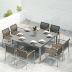 Outdoor Dining Furniture - The Zix Collection from Mamagreen™ features dining chairs with Batyline® mesh fabric upholstery and an dining table with a frosted glass table top.