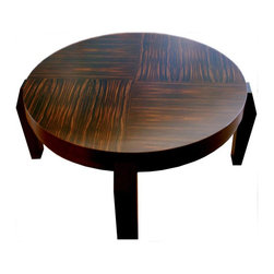 "Milan Heger - ""Cubist Coffee Table"" - ""Cubist Table"" is a coffee table with design echoes of Czech Cubism. The legs are sculptural. The finish is a Macassar Ebony wood veneer with a satin lacquer. The pattern of the wood grains are rotated 90 degrees each quarter circle. See image."