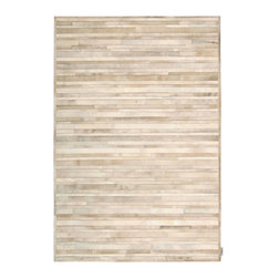 Nourison - Calvin Klein Home Prairie Contemporary Marble Pile Print Beige 4' x 6' Cowhide R - This collection of special skin rugs brings the beauty of nature inside.The cowhides' contrasting hues and alternating hair direction add to the design and sophistication of this unique all natural collection. This is an all natural animal skin product that with regular wear will change in look over time. This product is not recommended for high traffic areas such as dining rooms, and special care should be exercised when moving furniture.