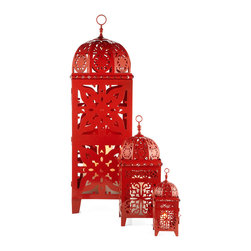 Casablanca Lanterns - Burnt Orange - Create your own kasbah with the exotic look of our spectacular Casablanca lanterns. Designed exclusively for Z Gallerie and inspired by lanterns commonly found in Moroccan souks, the lanterns are crafted of pierced metal and finished with this season's rich Burnt Orange. The real magic happens when candles are placed within, creating a pattern of light on surrounding objects and walls. The lanterns are available in three different sizes to create an interesting arrangement, or use a number of the same size. The largest lantern can hold several 3 inch diameter pillar candles, the medium size holds a single pillar candle or several votives, and the smallest holds a votive or tea light candle. Hinged and latched doors provide access to the candles. Sold individually.