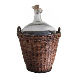 Vintner Wine Bottle & Basket - A extra large vintage wine bottle and carrier found in France. Wonderful large glass wine vessel with bubbled wavy glass and original wooden stopper. Basket original to the jug made of willow once lined with hay for protective transportation.