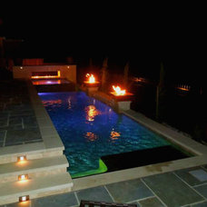 Contemporary Pool by Dallas Landscape Lighting