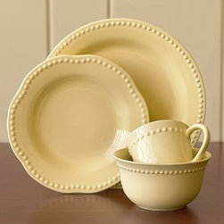 Emma Cup & Saucer, Set of 4, Yellow - Beaded detail enhances the comfortable appeal of earthenware, lending our Emma Dinnerware the look of an antique set. Created by Barbara Eigen, a well-known designer of unique handmade ceramics. Beautiful for entertaining, yet casual enough for everyday use. Glazed by hand. 16-piece set includes 4 dinner plates, 4 salad plates, 4 cereal or soup bowls and 4 mugs. 20-piece set includes 4 dinner plates, 4 salad plates, 4 cereal or soup bowls, 4 cups and 4 saucers. Food, dishwasher and microwave-safe. While dishes are microwave-safe, they may become hot. Handle carefully. Please take special care when microwaving liquids; hot liquids will transfer their heat to the container. Made in Portugal.