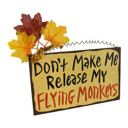 `Don`t Make Me Release My Flying Monkeys` Wooden Wall Plaque - This decorative wooden wall plaque features festive fall colors, and a stern warning. It measures 8 inches long, 6 inches tall, and hangs by a spiral wire hanger adorned with Fall leaves. The plaque is a cute decoration in your home or office, and makes a great gift for a coworker.