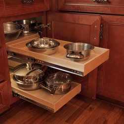 Kitchen Pull Out Shelves - Our blind corner pull out shelving solution increases the usable storage in your corner cabinets.  When the front shelf is extended, the shelf in the corner can be pulled over to allow easy access to those items.