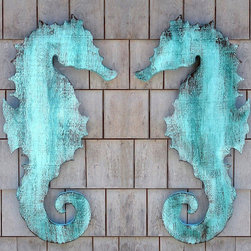 "Wooden Seahorse Wall Plaque - Our seahorses are made from rough wooden panels, cut and distressed by hand and sealed with deck paint.  They can be put outside to weather further, or inside as a decorative accent. Hanging hardware is included on the back. These are wonderfully rustic, with all of the natural wood grain and imperfections adding to the patina. Seahorses are sold individually, facing left or facing right, or you can buy them as a pair!  Available in distressed aqua blue or white. Each seahorse is 28"" tall."