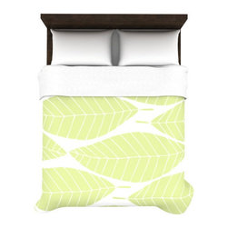 Sprout Duvet Cover - Wake up to spring every morning. This woven duvet cover is printed with oversized leaves in a delightful spring green. It's a perfect match for light, natural wood, and sunshine.