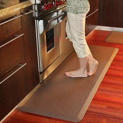 Wellness Mats - Wellness Mats Motif MT62WMR Trellis Anti Fatigue Mat - MT62WMRBLK - Shop for Safety Supplies from Hayneedle.com! Make your chores more comfortable with the help of the Wellness Mats Motif MT62WM Trellis Anti Fatigue Mat. Featuring an elegant geometric design the Trellis door mat brings form and function to your home. The polyurethane anti-fatigue mat is ergonomically engineered and medically proven to provide comfort and support while you stand. The door mat is designed to last as it is puncture- and heat-resistant and the edges will never curl. It also has a no-trip beveled edge. Plus the anti-microbial mat is easy to wipe clean. Available in your choice of color. Dimensions: 72L x 24W x 0.75H inches.