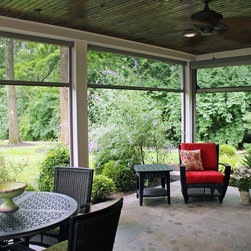 Retractable Patio/Lanai Screens - Retractable screens to let the breeze in and bugs out for this patio under the second story back deck