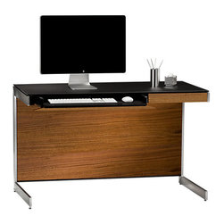 BDI - Sequel Compact Desk, Walnut - The Sequel Compact Desk is perfect for those needing to conserve office space. It has a modern and structured design with steel base. Features like cord management and an internal power strip make your desk space clean and organized. It comes equipped with a catch all top drawer. Choose from 3 color options.