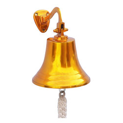 "Handcrafted Model Ships - Solid Brass US Navy Ship's Bell 9"" - Navy Bell - Elegantly designed and gleaming with a lustrous shine, this fabulous Brass US Navy Ship's Bell 9"" is equally stunning indoors or out. In addition to being fully functional, this ships bell is a great addition to any nautical decor themed room. Make a nautical wall decor statement and enjoy this wonderfully decorative style and distinct, warm ""strike through"" nautical tone with each and every resounding ring. Note: Each ships bell's length is measured from the highest point of its hanger to the lower lip of the bell, while the width is the diameter of the flared bell opening. Dimensions: 5.5"" Long x 5.5"" Wide x 9"" High"