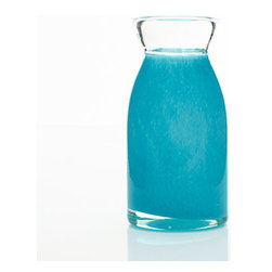 Ocean Blue Glass Vase - The Ocean Blue Glass Vase is artfully modern. Fill it with your favorite flowers to greet guests in your foyer, or place this vase anywhere that could use a delightful splash of color.