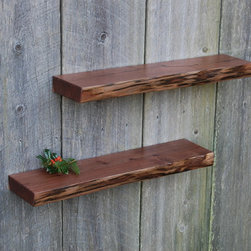 "Natural Edge Walnut Shelves - Unique pair of Walnut floating shelves. Air dried black walnut. Keyhole fasteners set at 16"" apart for fast, secure installation. Oil and varnish finish hand tooled edges."