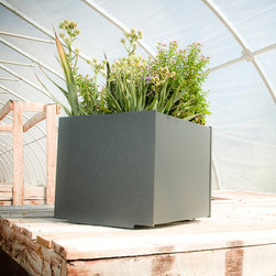 Loll Designs - 22 Gallon Square Planter - Loll Designs - The Loll Flora Collection was created to work in a variety of outdoor garden settings. The recycled and recyclable poly material is made to withstand the test of time and extreme weather. In addition, the joinery on our modern containers allow for a slow, seeping drainage and holes can easily be drilled in the bottom if desired. All pieces are flat-packed with simple, fun, and intuitive assembly.