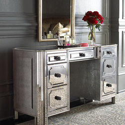 """Logan"" Mirrored Vanity/Desk - Antique mirrors add sparkle to a piece that works easily as a vanity or a desk. Made of select hardwoods with silver-leaf trim and antiqued silver hardware. Seven drawers keep secrets out of sight. 54""W x 20""D x 30""T."