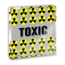 "Made on Terra - Toxic Warning Radiation Mini Desk Plaque and Paperweight - You glance over at your miniature acrylic plaque and your spirits are instantly lifted. It's just too cute! From it's petite size to the unique design, it's the perfect punctuation for your shelf or desk, depending on where you want to place it at that moment. At this moment, it's standing up on its own, but you know it also looks great flat on a desk as a paper weight. Choose from Made on Terra's many wonderful acrylic decorations. Measures approximately 4"" width x 4"" in length x 1/2"" in depth. Made of acrylic. Artwork is printed on the back for a cool effect. Self-standing."