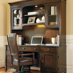 Hooker Furniture - Abbott Place Computer Credenza (Rich Warm Che - Finish: Rich Warm CherryDesk chair not included. Hutch is optional. Full height, depth and width drawers for maximum storage capacity. Strong English and French dovetail construction. Plywood drawer bottoms attached to plywood drawer sides for strength and durability. Full extension wood-on-wood or metal glide drawer systems operate smoothly. Made from hardwood solids and cherry veneers. Credenza:. Power bar with surge protector is accessible from desk top. Center drawer has drop-front for keyboard and from underneath unit. One locking file drawer takes letter and legal files. Top side drawers have one removable pencil tray and writing insert. Can be used on left and right side. One utility drawer with removable dividers. Right side door has pullout printer shelf and one adjustable shelf. Metal ball bearing slides. Keyboard drawer: 24.13 in. W x 12.94 in. D x 2.63 in. H. Knee space: 26 in. W x 20.13 in. D x 24.19 in. H. Printer space: 15.75 in. W x 17.13 in. D x 15.5 in. H. RSF door opening: 16.63 in. L x 17.5 in. W x 16.5 in. H. Overall: 66 in. W x 24 in. D x 30.5 in. H. Optional Hutch:. Three can lights controlled by three intensity touch switch. Two wood-framed beveled glass doors. One adjustable wood-framed glass shelf behind each door in center section. One task light. 69.25 in. W x 16.25 in. D x 50 in. H. Assembly Instructions. Drawer InstructionsAbbott Place takes a fresh spin on traditional styling for a look that blends the best of classic American influences with updated design. Offering a broad piece assortment for every room in your home.