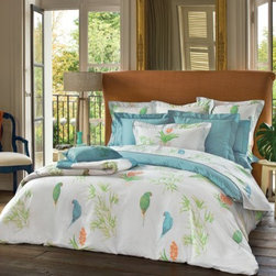 Yves DeLorme Fall Bedding - Bamboo canes and leaves punctuate the Postcard pattern, along with pairs of colorful parakeets-- all printed on white cotton sateen (Triomphe) cloth. An occasional minature vanda orchid in coral drifts across the pattern.  All inspired by tropical forests.  The shams and flat sheet are trimmed with Lagon piping and the shams reverse -- as does the duvet, to solid Triomphe in Lagon.