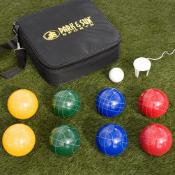 Park and Sun Sports - Park & Sun 109mm Attache Bocce Set Multicolor - BB-A109 - Shop for Backyard Games from Hayneedle.com! About the Park and Sun Attache This bocce set features a 9-section attache case for easy play and carrying. The phenolic resin 109 mm balls are color-coded in sets of two so that up to four duos can play. A 60 mm pallino is included as well as a measuring tool. The attached case zips shut and the shoulder strap aids transport. Casual players going to the next level will appreciate this tournament-quality set. Bocce Ball Materials and SizesResin is the most popular material for bocce balls and will withstand frequent use better than other materials. Molded plastic is best for children or for beginners and can be somewhat softer although still very durable. A bocce ball that is smaller than 100mm is typically best for children or for beginners. This size is easiest to handle and toss. Tournament balls will range between 107mm and 115mm. The International Standard ball is 107mm (4.2 inches) and weighs 920 grams (2 lbs.). The occasional backyard player will most likely appreciate a size somewhere between 100mm and 110mm. About Park and Sun SportsSince 1985 Park & Sun Sports has designed distributed and manufactured high-quality sporting goods athletic equipment and unique games from their headquarters in Englewood CO. Through the talents of their dedicated team and the inspiration of the consumer Park & Sun Sports will continue to demonstrate innovation quality passion and superior service through the products that they offer.